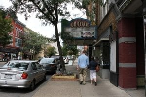 People walking by the Historic Glove Theatre in Gloversville, NY