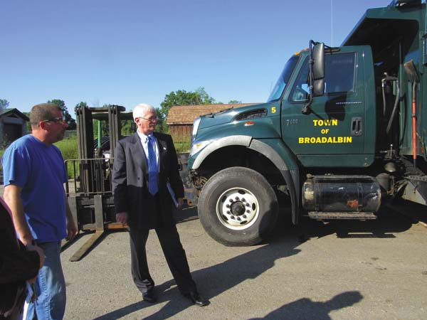Broadalbin Manufacturing Corp. shop foreman Ryan Sowle, left, shows Fulton County Center for Regional Growth President and CEO Ronald Peters a truck owned by the town of Broadalbin that the company is repairing during a tour of the machine shop by community leaders on Thursday.  (The Leader-Herald/Ashley Onyon)