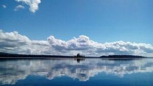 Smooth Sacandaga Lake reflecting a Cloud