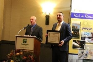 SLA Transport, Inc./Universal Warehousing, Inc. General Manager Andrew Olbrych, ith the Large Established Business Award during the Fulton County Center for Regional Growth's Fall Gala on Friday, Nov. 16, at the Holiday Inn Johnstown. Dusten Rader/Express Editor
