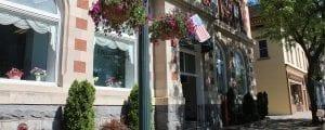 Gloversville street with summer flowers and historic streetlight