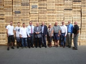 Group in front of Large tower of Pallets