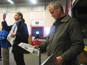 CRG board memeber Kent Kirch holds Friday's paper just fresh off the press in his hand