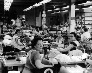 Women Sewing Leather